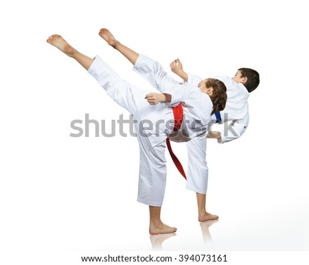 Man and woman performing a high kick - stock photo