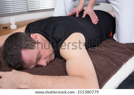 Man and woman performing back shiatsu massage