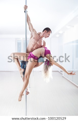 Man and woman pole dance team.