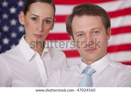 man and woman posing over american flag - stock photo