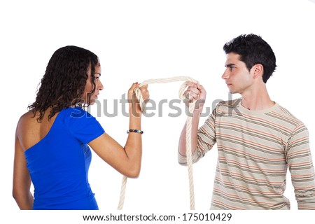 Man and woman pulling a rope competing (selective focus) - stock photo
