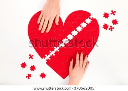 Man and Woman. Red heart puzzles. Relationship problems. Pair therapy. Two hands.  - stock photo