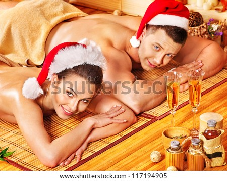Man and woman relaxing in Christmas spa. - stock photo