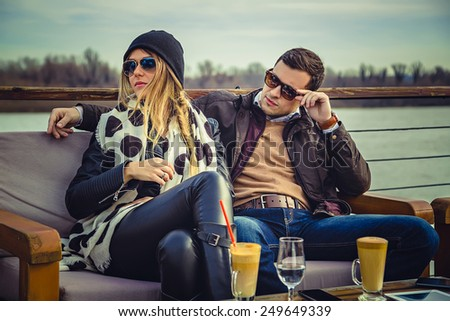 Man and woman seriously looking at something - stock photo