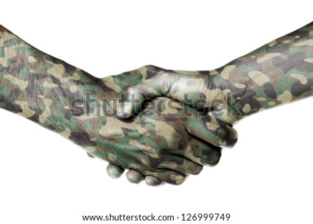 Man and woman shaking hands, camouflaged - stock photo