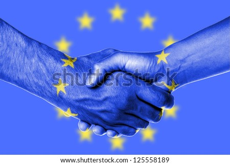 Man and woman shaking hands, wrapped in flag pattern, European Union - stock photo