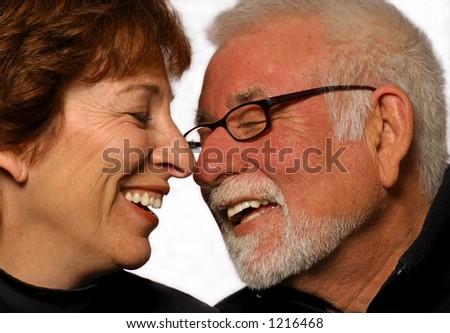 Man and woman share a joke - stock photo
