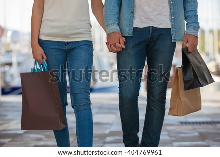 MAN AND WOMAN SHOPPING BAGS - stock photo