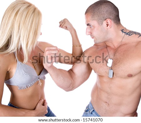 Man and woman showing who's biceps is stronger - stock photo