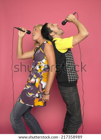 Man and woman singing - stock photo