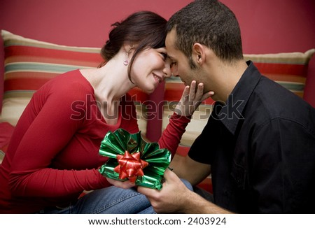 man and woman smiling and holding each other - stock photo