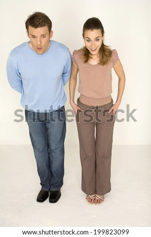 Man and woman standing, elevated view - stock photo
