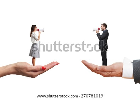 man and woman standing on the big palms and screaming at each other. isolated on white background - stock photo