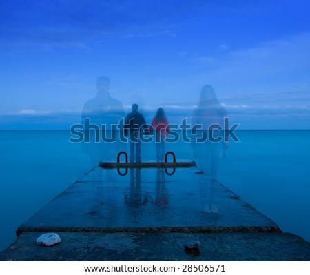 man and woman standing on the concrete pier - stock photo