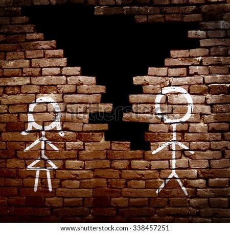 Man and woman stick figures on broken brick wall -- divorce concept                             - stock photo