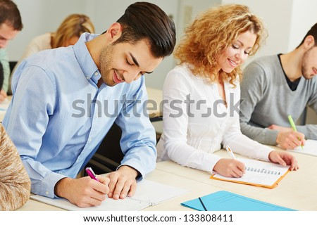 Man and woman taking employee screening in assessment center - stock photo