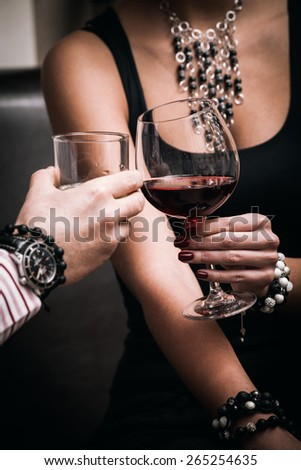 man and woman toast with glasses,  close up, indoor shot, selective focus - stock photo