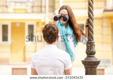 Man and woman tourists. They came on a trip to another city. Tourist, travel, map, binoculars, a pair of man and woman on a city street. Love story of two young travelers come on vacation, summer day. - stock photo