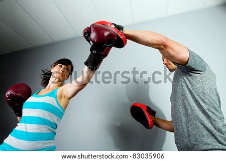 Man and Woman training to box in a gym - stock photo