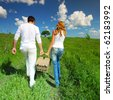 man and woman walk on picnic - stock photo