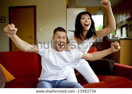 Man and woman watching tv together