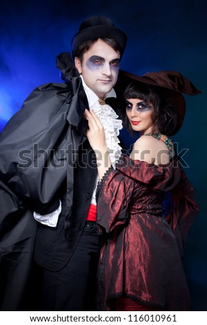 man and woman  wearing  as  vampire and  pregnant witch. Halloween - stock photo