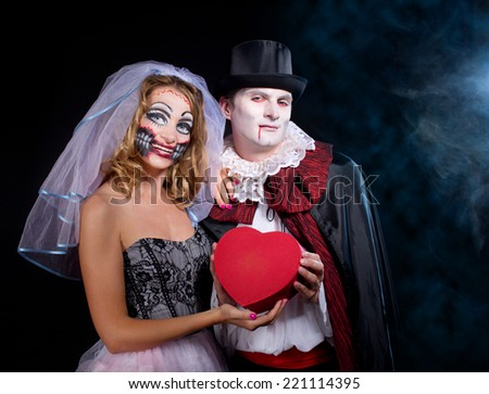 man and woman  wearing  as  vampire and terrible girl . Halloween - stock photo