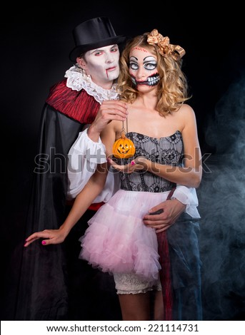 man and woman  wearing  as  vampire and terrible girl . Halloween