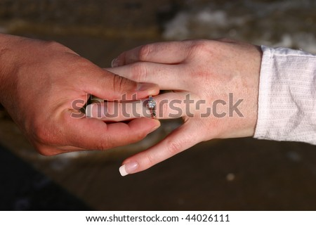 man and woman with a diamond ring