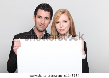 Man and woman with a white panel