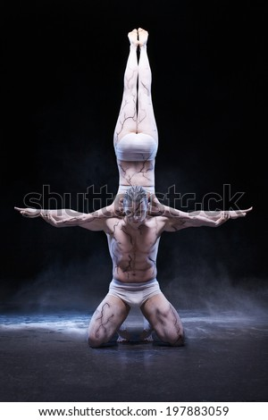 Man  and woman with acrobatics pose  - stock photo