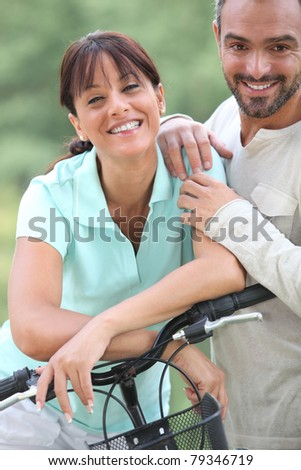 Man and woman with bike - stock photo