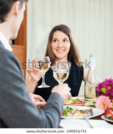 Man and woman with glasses on a romantic date - stock photo