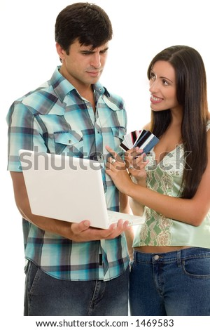 Man and woman with laptop and credit cards.    Online shopping, auctions, banking, finance, e-commerce, etc. - stock photo