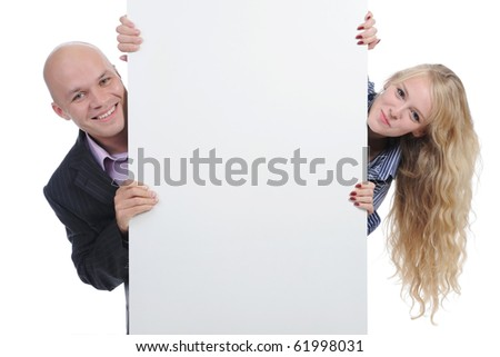 man and woman with large blank. Isolated on white background - stock photo