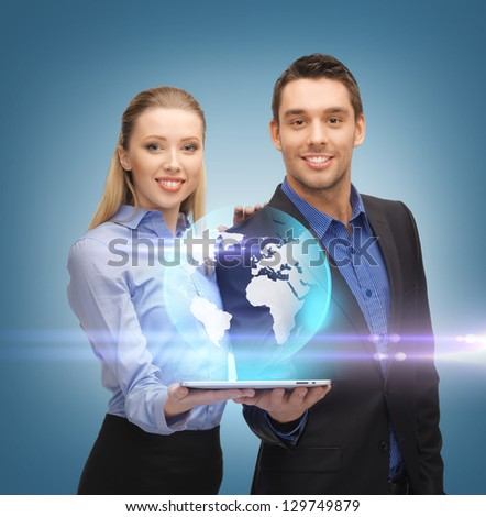 man and woman with virtual globe from tablet pc - stock photo