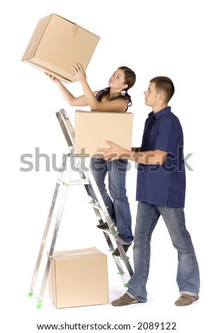 man and woman (workers) at the ladder with boxes - stock photo