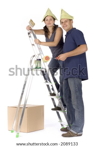 man and woman (workers) at the ladder with paint - stock photo