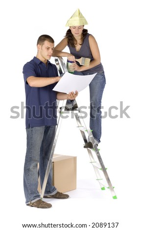 man and woman (workers) at the ladder with plan and paint - stock photo
