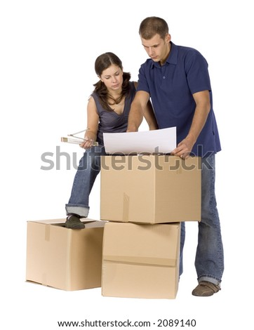 man and woman (workers) standing at the cardboard boxes - stock photo