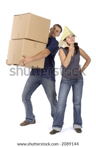 man and woman (workers) standing with boxes and paintbrush - stock photo