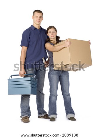 man and woman (workers) standing with cardboard box and toolbox - stock photo