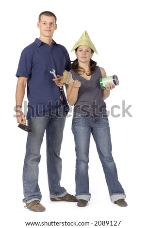man and woman (workers) standing with tools and paint - stock photo