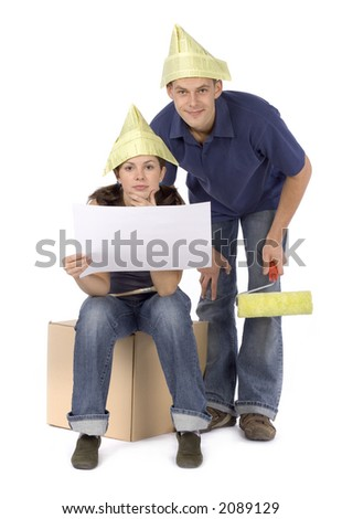 man and woman (workers) study house plan - stock photo