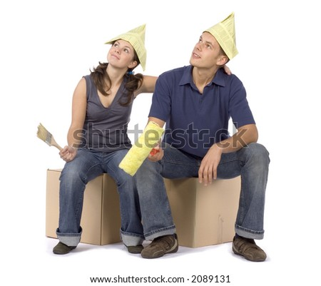 man and woman (workers) with paintbrush and roller - stock photo