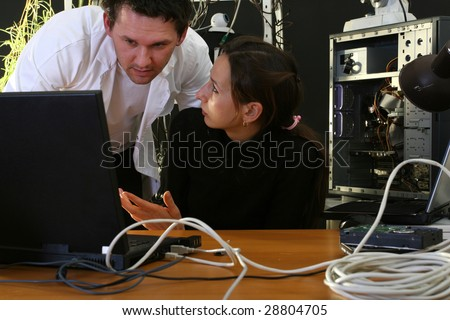 man and woman working on computer in the labor - stock photo