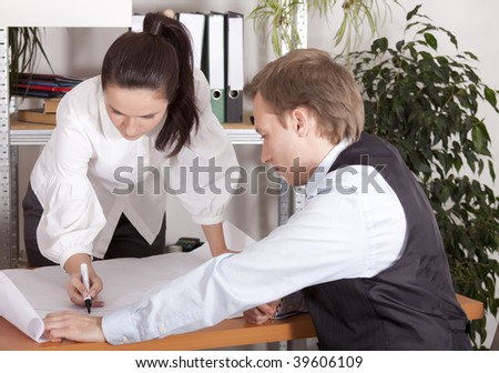 man and woman working together on project - stock photo