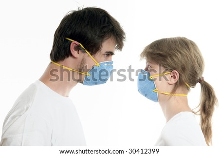 Man and woman 20-35 years  in blue respirators face to face against white background - stock photo