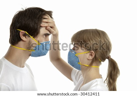 Man and woman 20-35 years  in  respirators face to face against white background - stock photo