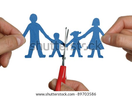 Man and womans hands cutting paper chain family concept for divorce and child custody battle - stock photo